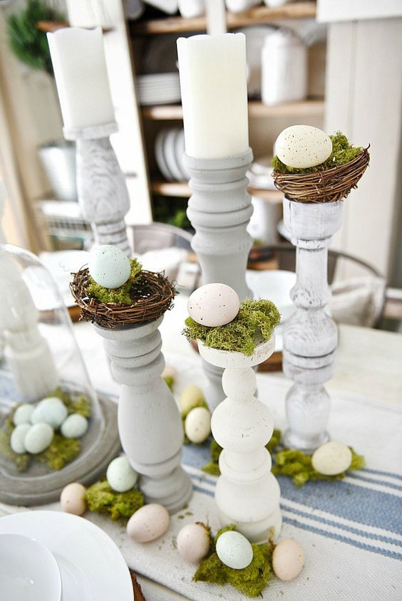 table decor with eggs on stands, moss and nests