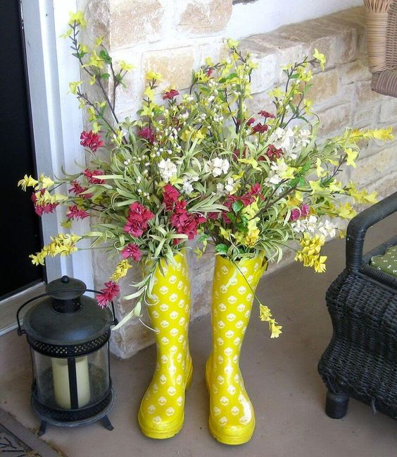 upcycled rainboots as a vase for spring blooms