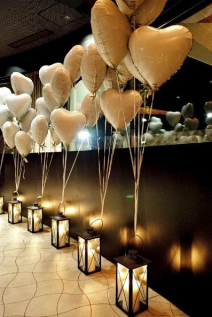 heart-shaped balloons attached to lanterns for a bold and fun look