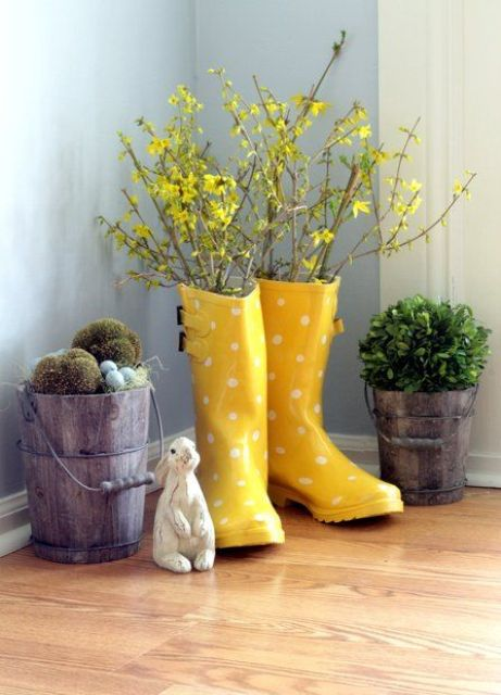 yellow polka dot rainboots as a vase, boxwood and moss