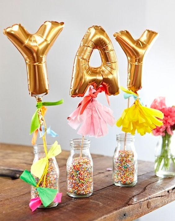 YAY gold balloons in glass bottles with confetti