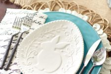 20 a wicker platter, a blue plate and a bunny plate on top