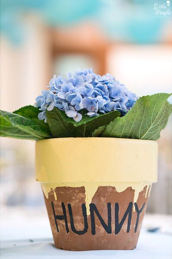 hunny pot with blue hydrangeas for Winnie the Pooh themed shower