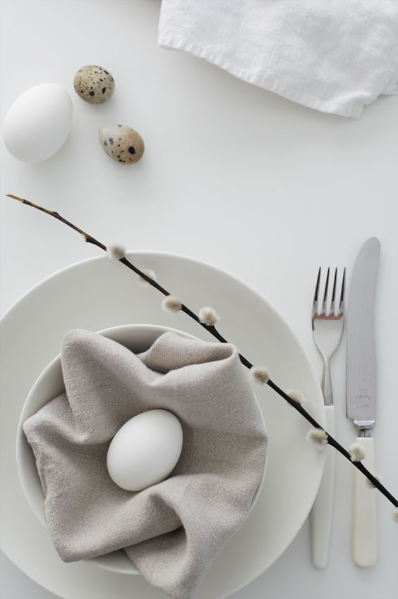 modern table setting with willow, a neutral napkin and an egg