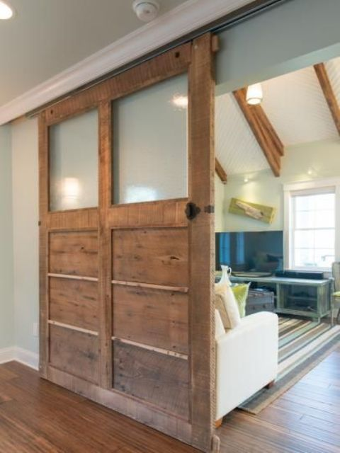 reclaimed wood and sheer glass doors