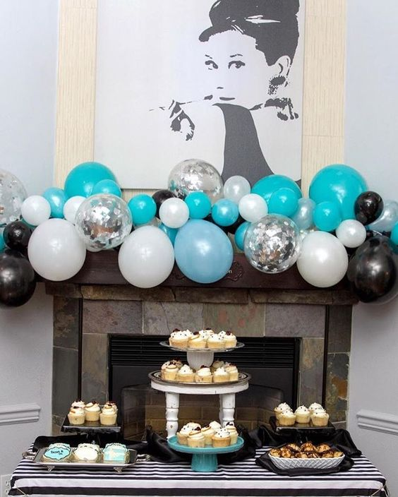 turquoise, white and black balloon fireplace decor for a themed party