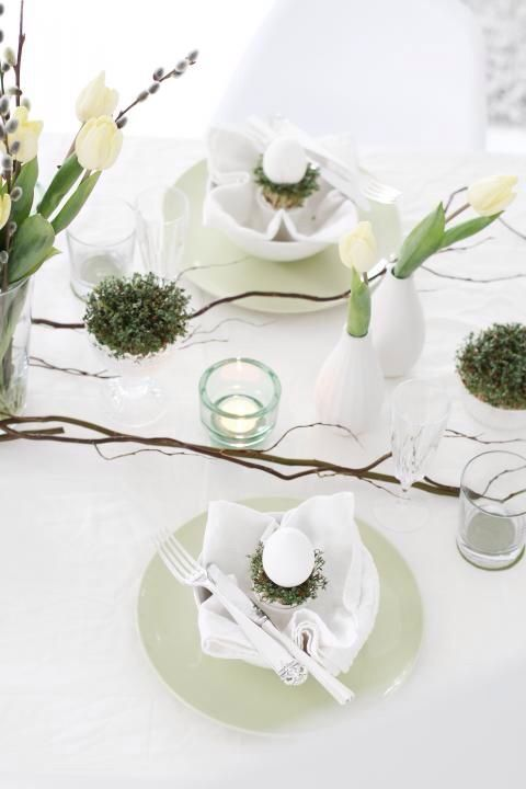 modern tablescape with wihte tulips, greenery and white eggs