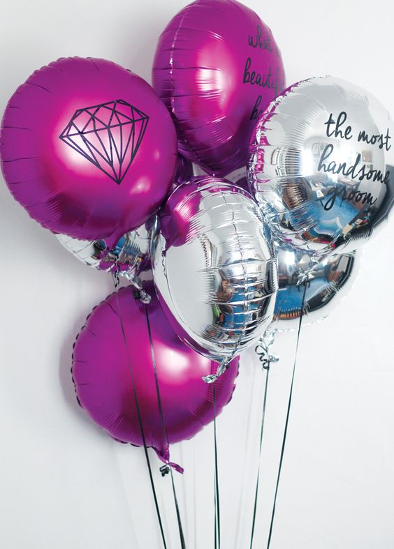 neon pink and silver balloons for a modenr engagement party