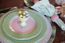 21 sage green plates and tiny eggs in a cup