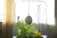 21 spring terrarium with a concrete base, greenery, snowdrops and an egg hanging