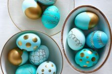 21 turquoise and gold patterned Easter eggs