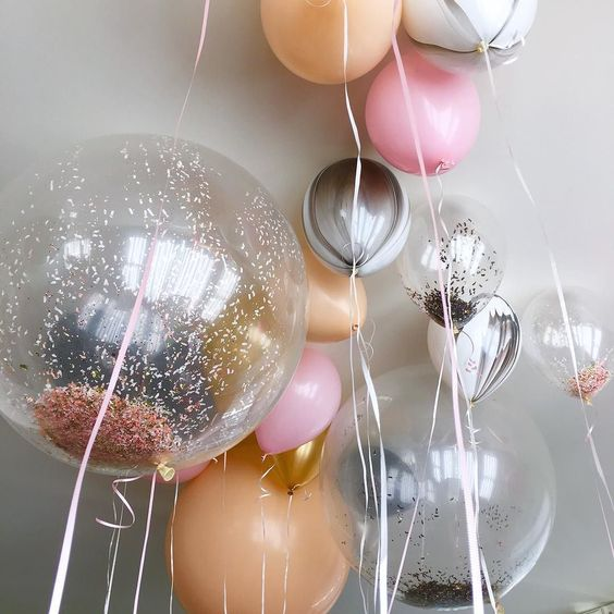 various balloons with sparkles and confetti will create a party mood
