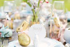 22 a blue napkin, a gold glitter bunny and a card