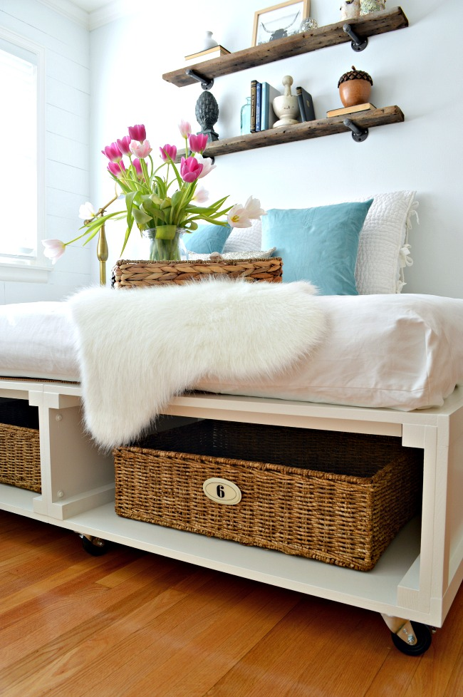 DIY platfrom bed with storage baskets inside (via www.chatfieldcourt.com)