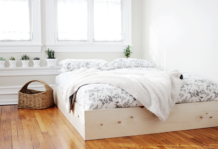 very simple DIY bed frame of wood (via themerrythought.com)