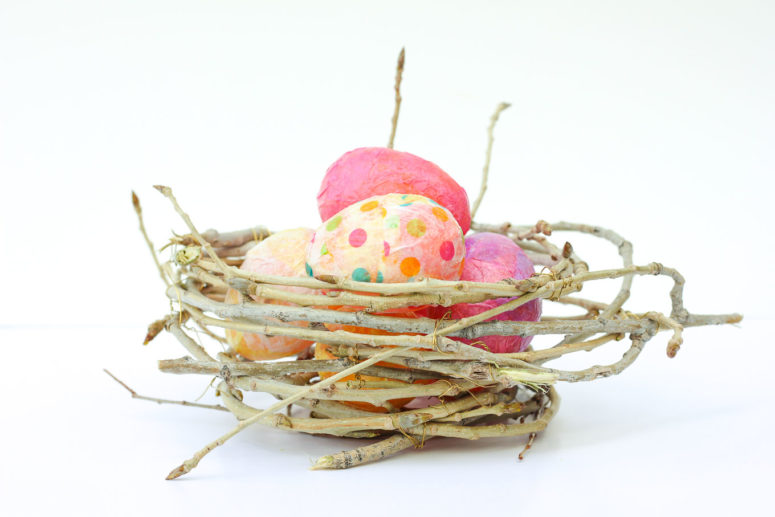 DIY Easter nest with colorful eggs (via makeanddocrew.com)