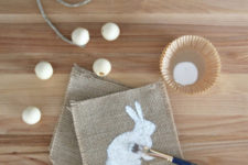 DIY burlap banner with painted bunnies and beads