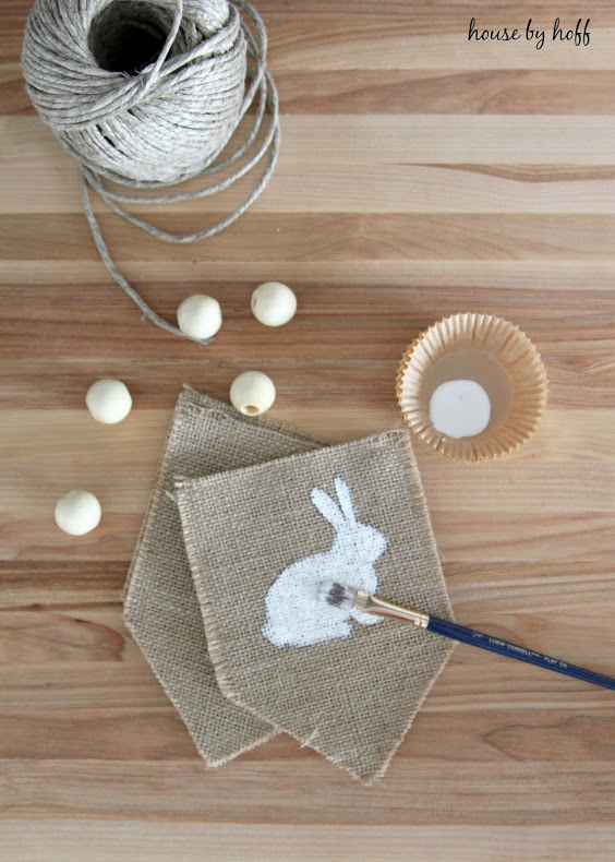 DIY burlap banner with painted bunnies and beads (via www.housebyhoff.com)