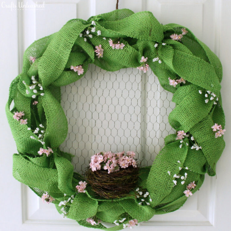 DIY sage green burlap Easter wreath with a nest (via blog.consumercrafts.com)