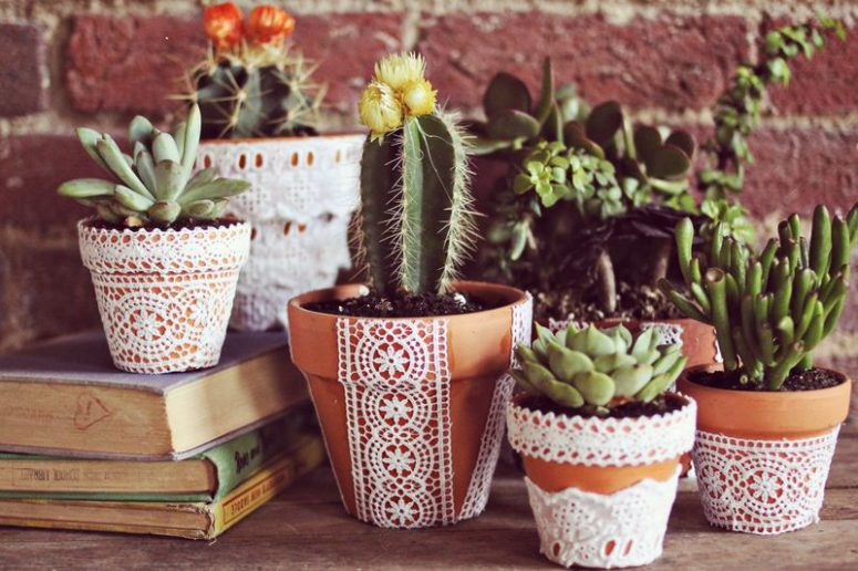 DIY lace flower pots for spring (via www.abeautifulmess.com)