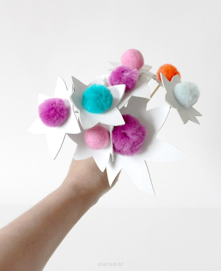 DIY pompom flowers with leather (via kraftmint.com)