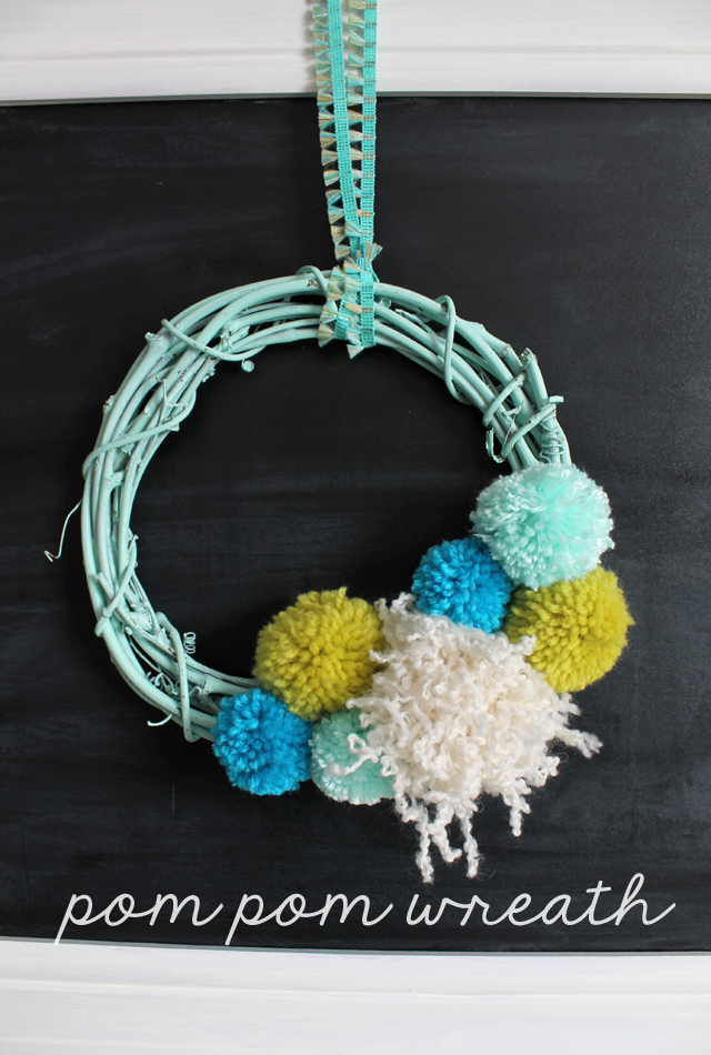 DIY mint oversized pompom wreath for spring decor (via www.sisterssuitcaseblog.com)