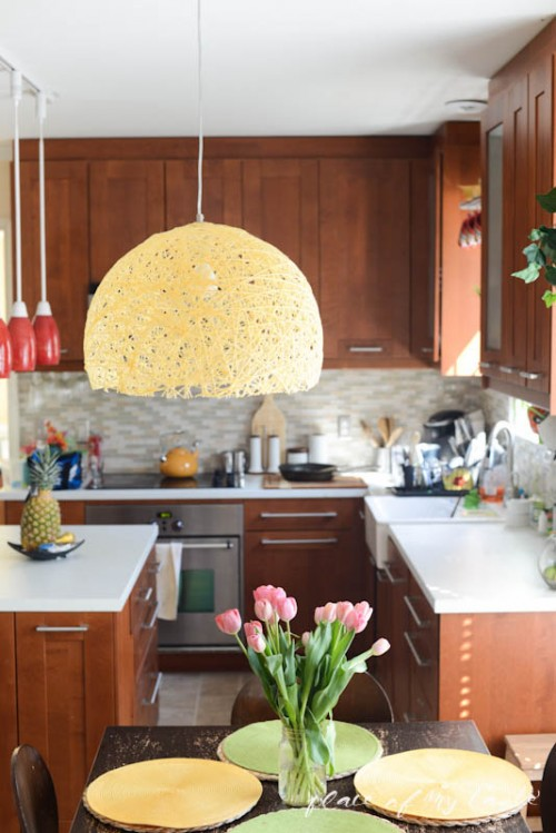 DIY sunny yellow yarn lampshade (via www.shelterness.com)