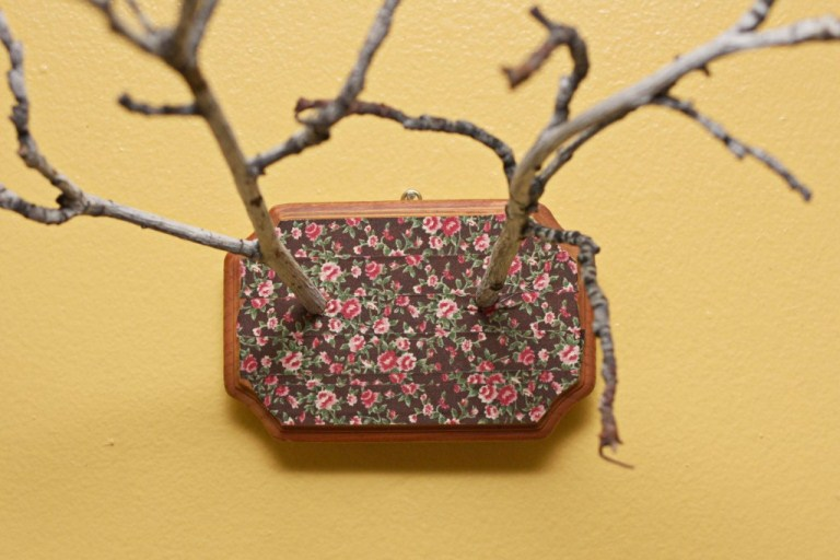 DIY twigs and floral fabric wall art (via www.shelterness.com)