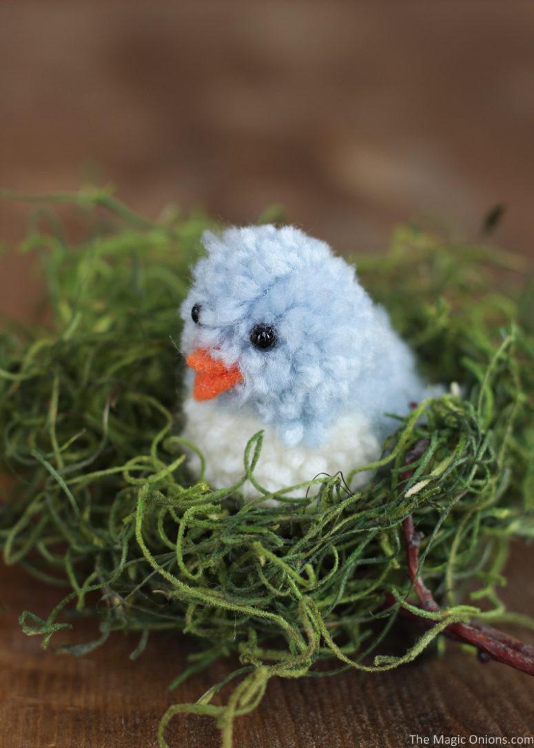 DIY blue pompom birds for Easter decor (via www.themagiconions.com)