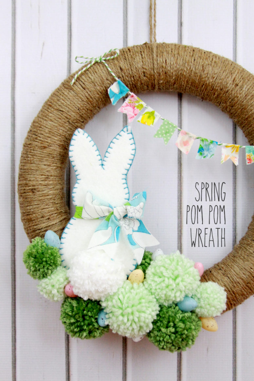 DIY bunny and eggs pompom Easter wreath (via https:)