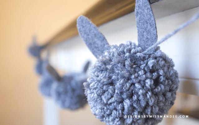 DIY pompom Easter bunny garland (via www.designsbymissmandee.com)