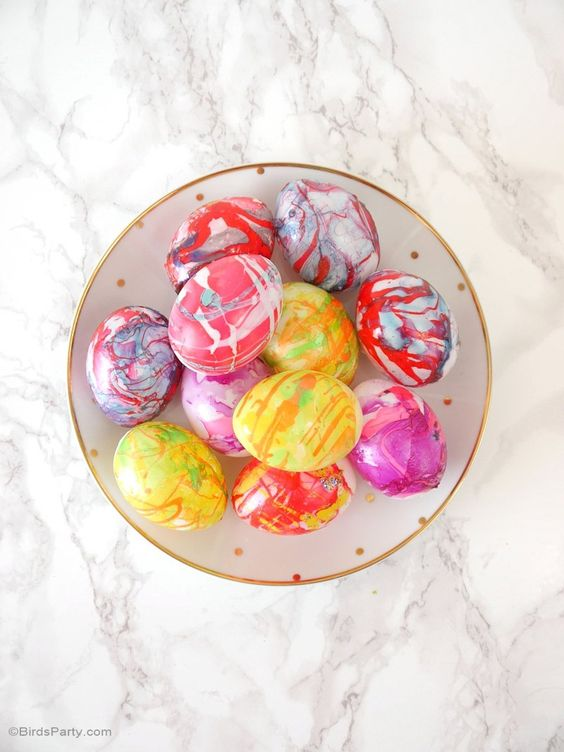 vibrant marbelized Easter eggs in red, pink, yellow
