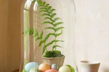 02 a cloche with moss, pastel dyed eggs and ferns
