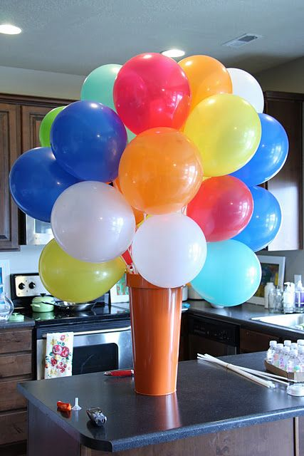 a cone vase with a super colorful balloons bouquet