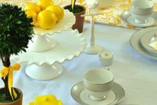 02 a mint tablecloth with yellow patterned textiles and yellow dishes
