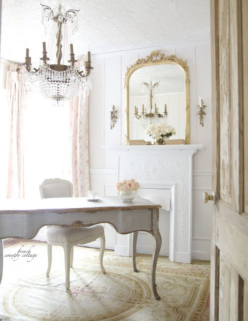 a neutral-colored office with blush floral curtains and off-white furniture