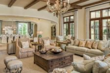 02 all-neutral living room in warm shades with shabby chic furniture and wooden beams on the ceiling