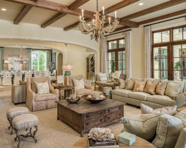 Beautiful all neutral living room in warm shades with shabby chic furniture and wooden beams on