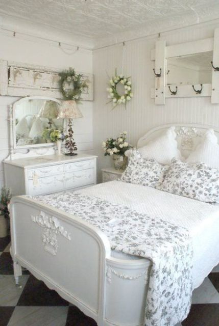 all-white room with floral patterns, refined French-inspired furniture