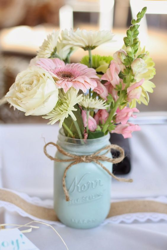 mint painted mason jars with twine and simple flowers