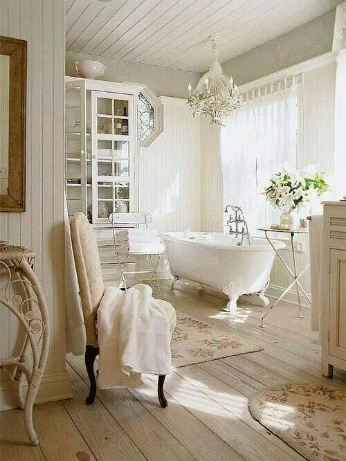 Superieur Tranquil All White Bathroom With A Glass Cabinet And A Gorgeous Chandelier  Over The Tub
