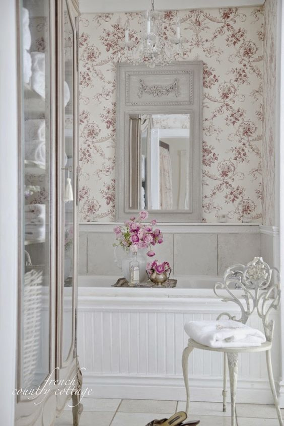 floral wallpaper in soft pink shades is a great idea for a girlish bathroom