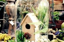 04 a cloche with a bird house, faux eggs, fern and greenery