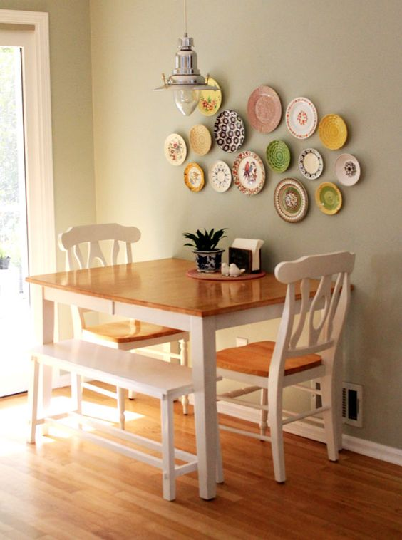 a colorful decorative plate arrangement over the dining space