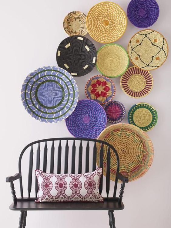 enliven your entyway with colorful wall baskets