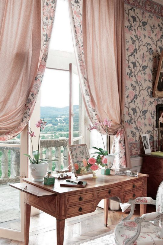pink and floral home office with a pink teak desk