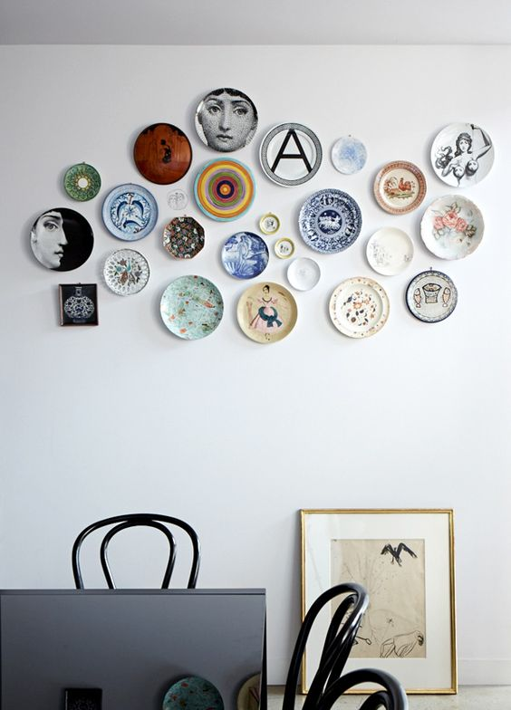 an eclectic plate collection will make any space more eye-catchy