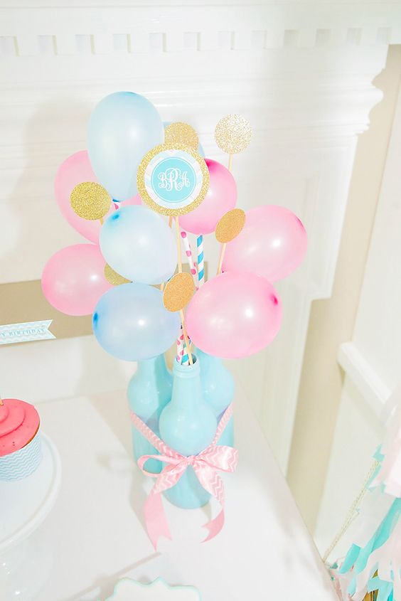 blue bottles with blue and pink balloons on straws
