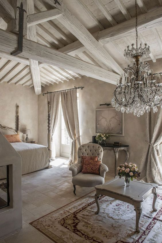 light grey room with whitewashed wooden beams and furniture, plaster walls add texture too