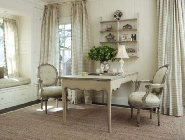 neutral and elegant home office with neutral fabrics and refined furniture